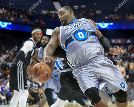 Saturday  - Power's Glen Davis makes a spin move under the basket during the Big3 game between Power vs the Enemies at the Allstate Arena in Rosemont, IL. Gary E