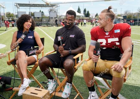 NFL Network reporter MJ Acosta, left, with analyst James Jones and San Francisco 49ers tight end George Kittle, right, on the set during the 49ers training camp at their NFL football training facility in in Santa Clara, Calif