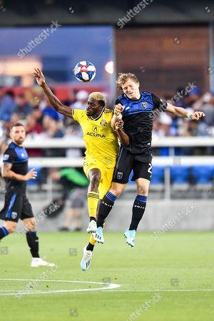 San Jose Earthquakes midfielder Florian Jungwirth (23) and Columbus Crew SC midfielder David Guzman (9) fight for the header during the MLS match between Columbus Crew SC and the San Jose Earthquakes at Avaya Stadium in San Jose, California