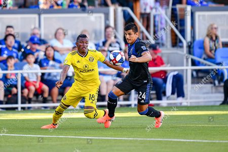 Columbus Crew SC forward Robinho (18) works to gain possession from San Jose Earthquakes defender Nick Lima (24) during the MLS match between Columbus Crew SC and the San Jose Earthquakes at Avaya Stadium in San Jose, California