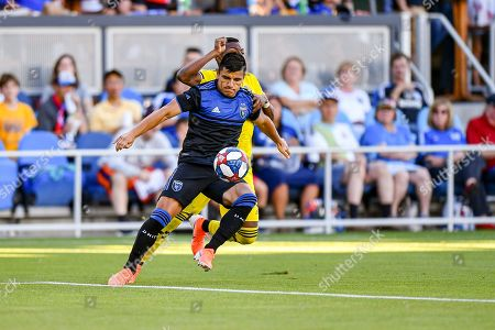 San Jose Earthquakes defender Nick Lima (24) gains possession from Columbus Crew Columbus Crew SC forward Robinho (18) during the MLS match between Columbus Crew SC and the San Jose Earthquakes at Avaya Stadium in San Jose, California