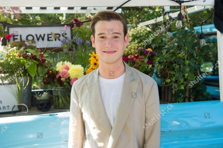 Stock Picture of Tyler Henry attends Bella Magazine's 7th annual White Party at Southampton Social Club, in Southampton, NY