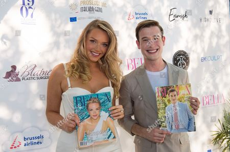 Tyler Henry, Camille Kostek. Camille Kostek, left, and Tyler Henry attend Bella Magazine's 7th annual White Party at Southampton Social Club, in Southampton, NY
