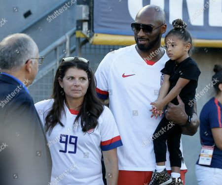 Stock Photo of Former United States player Mia Hamm, second from left, stands with former Los Angeles Lakers player Kobe Bryant, and his daughter Bianka Bryant, before an international friendly soccer match against Ireland in Pasadena, Calif