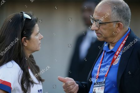 Carlos Cordeiro, right, president of the United States Soccer Federation talks with former United States soccer player Mia Hamm before an international friendly soccer match against Ireland in Pasadena, Calif