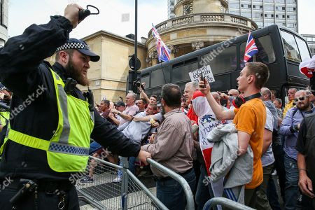 Police clashe with supporters of Stephen Yaxley-Lennon, known as Tommy Robinson during a protest in central London