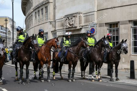 Police on horseback during the Free Tommy Robinson Protest in central London