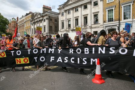 Anti Tommy Robinson protesters demonstrate in central London