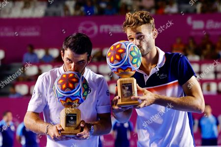 Monegasque players Romain Arneodo (L) and Hugo Nys (R) celebrate with trophies after beating Dominic Inglot of Britain and Austin Krajicek of the USA, during the doubles final of the Los Cabos Tennis Open in Los Cabos, Baja California, Mexico, 03 August 2019.