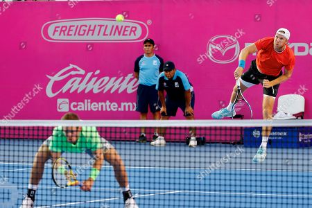 Dominic Inglot (R) of Britain and Austin Krajicek (L) of the USA in action against the Monegasque players Romain Arneodo and Hugo Nys during the doubles final of the Los Cabos Tennis Open in Los Cabos, Baja California, Mexico, 03 August 2019.