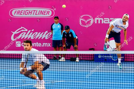 Monegasque players Romain Arneodo (L) and Hugo Nys (R) in action against Dominic Inglot of Britain and Austin Krajicek of the USA during the doubles final of the Los Cabos Tennis Open in Los Cabos, Baja California, Mexico, 03 August 2019.