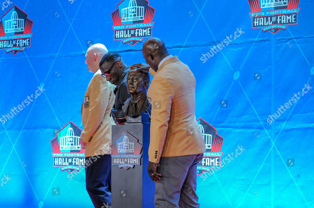 rd, John Elway, Shannon Sharpe, Terrell Davis posing with Pat Bowlen's bust during the Pro Football Hall of Fame Enshrinement in Canton, OH