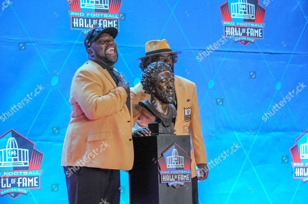 Stock Picture of rd, Ed Reed and Warren Sapp during the Pro Football Hall of Fame Enshrinement in Canton, OH