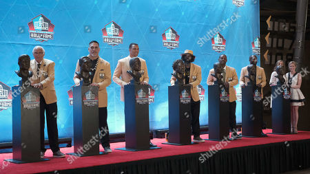 Stock Picture of rd, Gil Brandt, Johnny Robinson, Kevin Mawae, Pat Bowlen, Ty Law, Ed Reed, Champ Bailey, Tony Gonzalez during the Pro Football Hall of Fame Enshrinement in Canton, OH