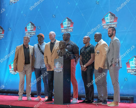 rd, John Elway, Von Miller, Shannon Sharpe, Terrell Davis, Chris Harris, Eric Decker posing with Pat Bowlen's bust during the Pro Football Hall of Fame Enshrinement in Canton, OH