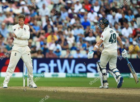 Joe Root of England looks dejected next to Steve Smith of Australia