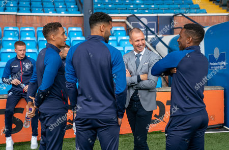 Former Rangers player Kenny Miller chats with James Tavernier, Connor Goldson & Jermain Defoe of Rangers shortly after the Rangers team arrived at Rugby Park.
