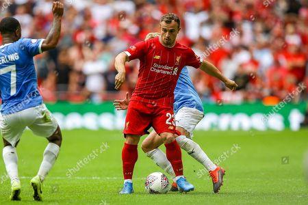Liverpool midfielder Xherdan Shaqiri (23) avoids a challenge from Manchester City midfielder Oleksandr Zinchenko (11) during the FA Community Shield match between Manchester City and Liverpool at Wembley Stadium, London