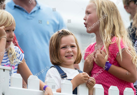 Isla Phillips, Mia Grace Tindall and Savannah Phillips watch the Shetland Pony Grand National