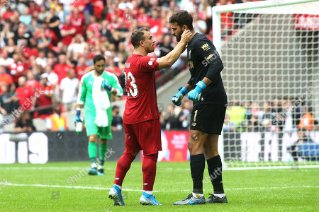 Xherdan Shaqiri of Liverpool speaks to goalkeeper, Alisson Becker, in the penalty shoot-out during Manchester City vs Liverpool, FA Community Shield Football at Wembley Stadium on 4th August 2019
