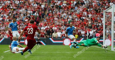 Liverpool's Xherdan Shaqiri shoots at goal but his shot is saved by Manchester City's goalkeeper Claudio Bravo during the Community Shield soccer match between Manchester City and Liverpool at Wembley Stadium in London