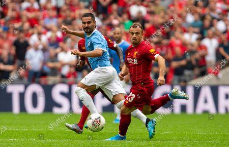 Xherdan Shaqiri of Liverpool with Ilkay Gündo?an of Manchester City