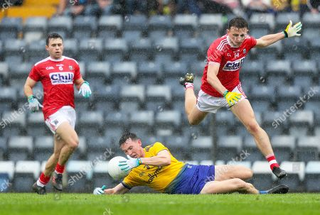 Cork vs Roscommon. Cork's Mark Collins and Stephen Cronin with Tadgh O'Rourke of Roscommon