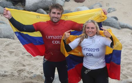 Giorgio Gomez, Isabella Gomez. Giorgio Gomez and his sister Isabella Gomez, of Colombia, pose for photos after the pair both won a gold medal for paddle, in the women's and men's SUP surfing events, during the Pan American Games on Punta Rocas beach in Lima Peru