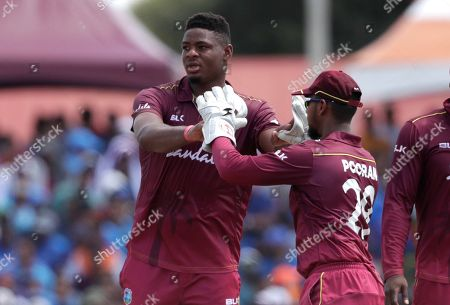 Keemo Paul, Nicholas Pooran. West Indies' Keemo Paul, left, is congratulated by Nicholas Pooran after taking the wicket of India's Rishabh Pant during the second Twenty20 international cricket match, in Lauderhill, Fla