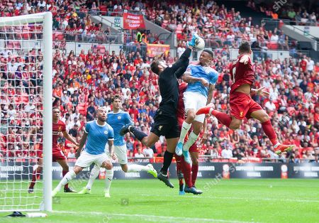 Alison Becker of Liverpool catches the ball from a corner