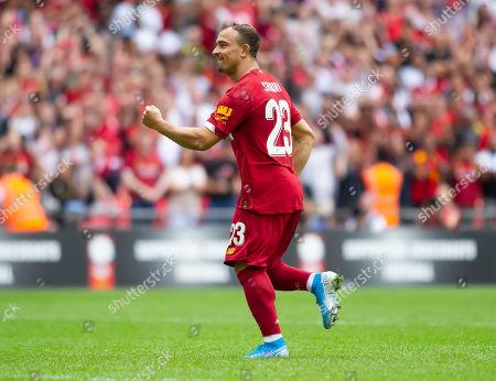 Xherdan Shaqiri of Liverpool celebrates after scoring in the penalty shootout