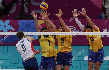 Thiago Pontes (2-L), Eder Carbonera (2-R) and Lucas Loh (R) of Brazil in action against Dusan Bonacic (L) of Chile during the men's volleyball match between Chile and Brazil at the Lima 2019 Pan American Games Lima, played at the Callao Sports Center in Lima, Peru, 04 August 2019.