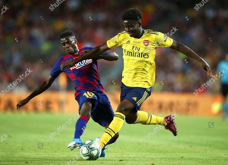 FC Barcelona's Moussa Wague (L) in action against Arsenal's Bukayo Saka (R) during the Joan Gamper Trophy soccer match between FC Barcelona and Arsenal FC at Camp Nou in Barcelona, Spain, 04 August 2019.