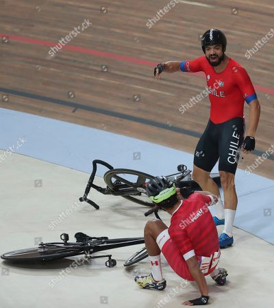 Antonio Cabrera of Chile argues with Renato Tapia of Peru after they fell during the track cycling men's madison final at the Pan American Games in Lima, Peru