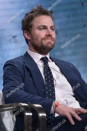 "Stephen Amell participates in The CW ""Arrow: Final Season"" panel during the Summer 2019 Television Critics Association Press Tour at the Beverly Hilton Hotel, in Beverly Hills, Calif"