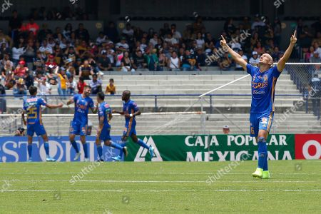 Tigres's Jorge Torres Nilo, right, celebrates after his team scored against Pumas during a Mexican Soccer Leage game in Mexico City