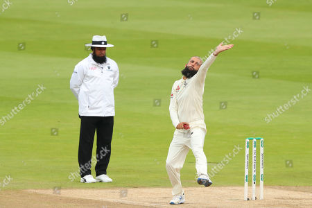 BIRMINGHAM, ENGLAND. 04 AUGUST Umpire Aleem Dar looks on as Moeen Ali of England bowls the ball during day 3 of the 1st Specsavers Ashes Test Match, at Edgbaston Cricket Ground, Birmingham, England