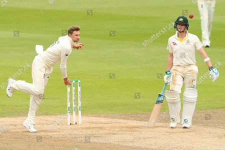 BIRMINGHAM, ENGLAND. 04 AUGUST Joe Root of England bowling as Steve Smith of Australia looks on during day 3 of the 1st Specsavers Ashes Test Match, at Edgbaston Cricket Ground, Birmingham, England