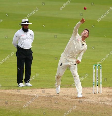 BIRMINGHAM, ENGLAND. 04 AUGUST Umpire Aleem Dar looks on as Joe Denly of England bowls the ball during day 3 of the 1st Specsavers Ashes Test Match, at Edgbaston Cricket Ground, Birmingham, England