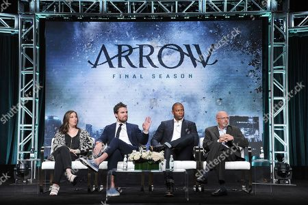 "Beth Schwartz, Stephen Amell, David Ramsey, Marc Guggenheim. Beth Schwartz, from left, Stephen Amell, David Ramsey and Marc Guggenheim participate in The CW ""Arrow: Final Season"" panel during the Summer 2019 Television Critics Association Press Tour at the Beverly Hilton Hotel, in Beverly Hills, Calif"
