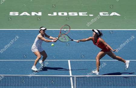 Japan's Shuko Aoyama, left, and Ena Shibahara try to return the ball against United States' Nicole Melichar and Czech Republic's Kveta Peschke during the doubles final of the Mubadala Silicon Valley Classic tennis tournament in San Jose, Calif