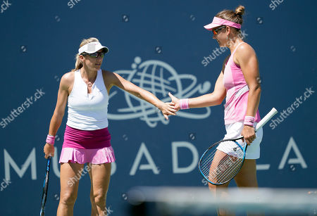 United States' Nicole Melichar, right, and Czech Republic's Kveta Peschke congratulate each other after winning a point against Japan's Shuko Aoyama and Ena Shibahara during the doubles final of the Mubadala Silicon Valley Classic tennis tournament in San Jose, Calif