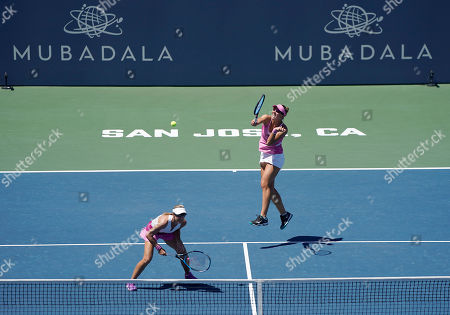 United States' Nicole Melichar, right, and Czech Republic's Kveta Peschke return the ball during a doubles final match of the Mubadala Silicon Valley Classic tennis tournament against Japan's Shuko Aoyama and Ena Shibahara in San Jose, Calif