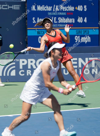 Japan's Ena Shibahara, top, returns a ball with partner Shuko Aoyama against United States' Nicole Melichar and Czech Republic's Kveta Peschke during the doubles final of the Mubadala Silicon Valley Classic tennis tournament in San Jose, Calif