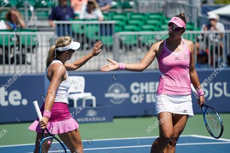 United States' Nicole Melichar, right, and Czech Republic's Kveta Peschke congratulate each other after winning the first set against Japan's Shuko Aoyama and Ena Shibahara during the doubles final of the Mubadala Silicon Valley Classic tennis tournament in San Jose, Calif