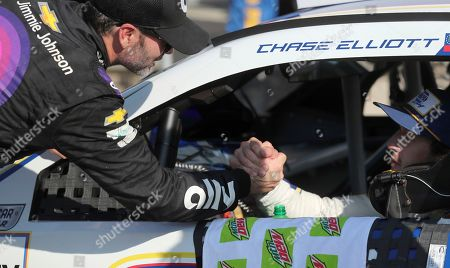 Jimmie Johnson, who finished in 19th place, congratulates race winner Chase Elliott after the NASCAR Cup Series auto race at Watkins Glen International, in Watkins Glen, N.Y