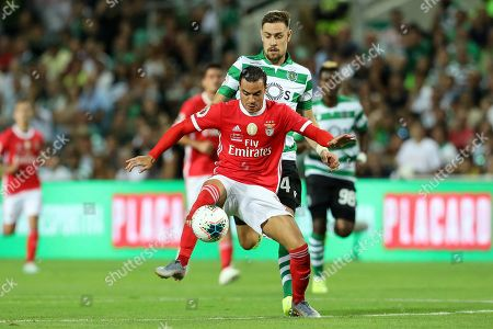 Raul de Tomás of SL Benfica (L) vies for the ball with Sebastian Coates of Sporting CP (R)