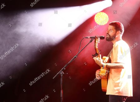Stock Photo of An English musician, singer and songwriter, Nick Mulvey performs on Day Two of the world renowned Cambridge Folk Festival at the Cherry Hinton Hall in Cambridge.