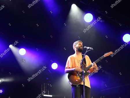An English musician, singer and songwriter, Nick Mulvey performs on Day Two of the world renowned Cambridge Folk Festival at the Cherry Hinton Hall in Cambridge.