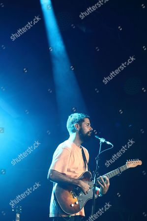 Stock Picture of An English musician, singer and songwriter, Nick Mulvey performs on Day Two of the world renowned Cambridge Folk Festival at the Cherry Hinton Hall in Cambridge.